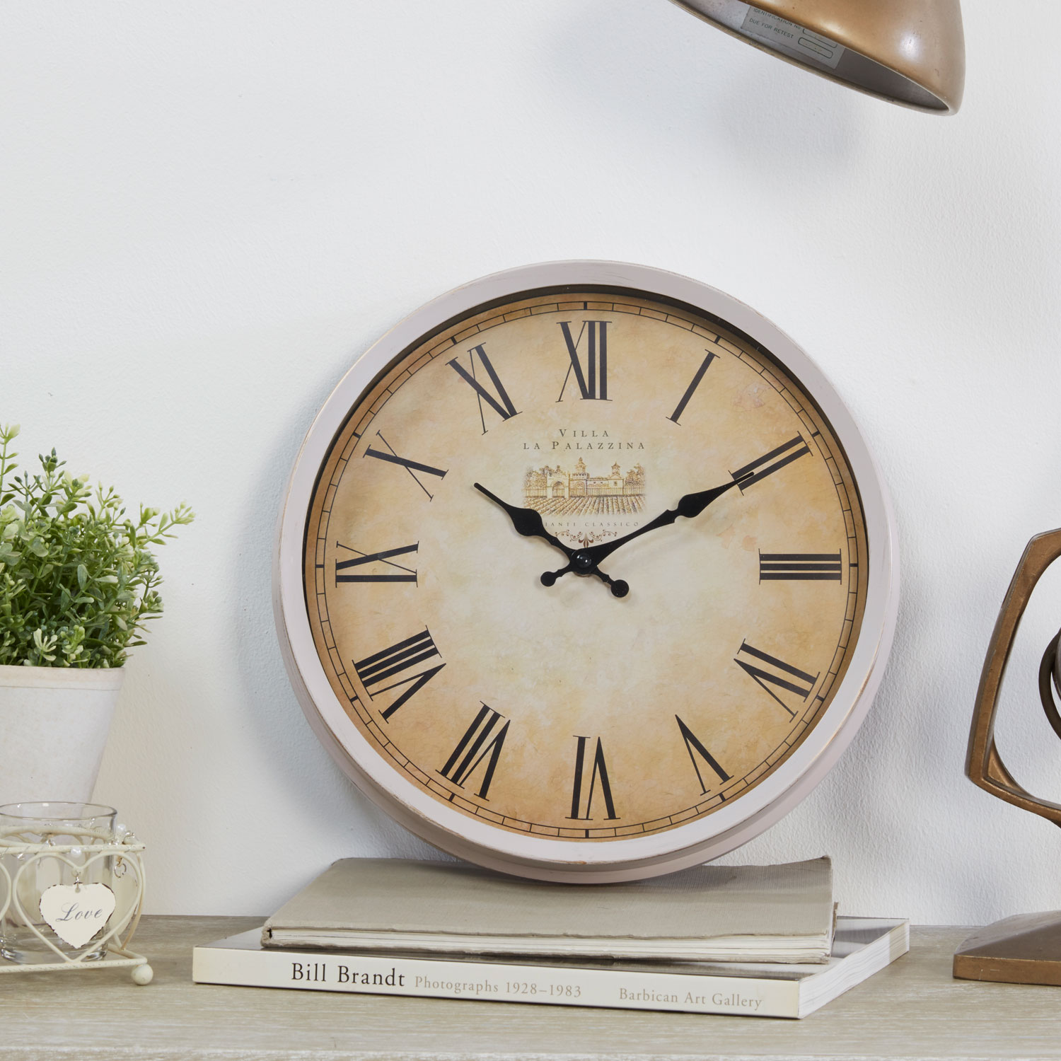 Stockists of Antique Cream Roman Dial Wall Clock
